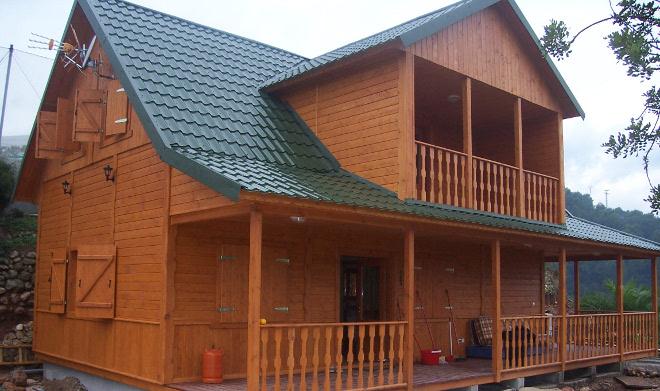 Construir con madera para luchar contra el cambio clim tico - Como se construye una casa de madera ...
